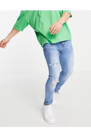River Island Spray on ripped jeans in light