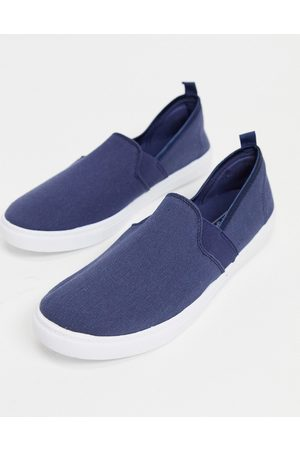 Truffle Collection Canvas slim on plimsolls in navy