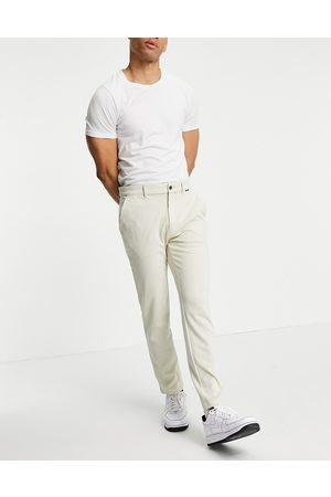 Calvin Klein Comfort knit slim fit chino trousers in bleached stone-Neutral