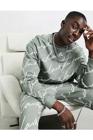 ASOS Tracksuit in khaki with all over signature print
