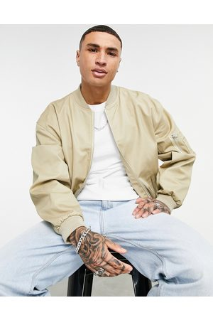 ASOS Oversized bomber jacket in stone-Neutral