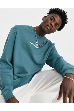 ASOS ASOS Daysocial relaxed sweatshirt in with white small chest logo print
