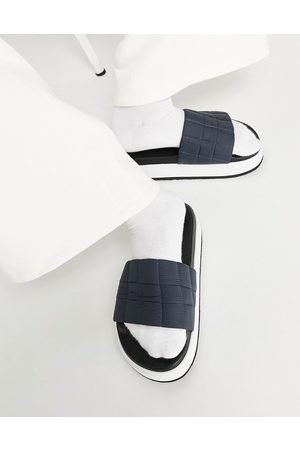 ASOS DESIGN Quilted slider with pumped up sole in navy