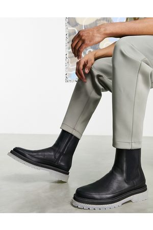 ASOS Chelsea calf boots in faux leather with translucent chunky sole