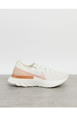 Nike React Infinity Run Flyknit trainers in ivory and pink