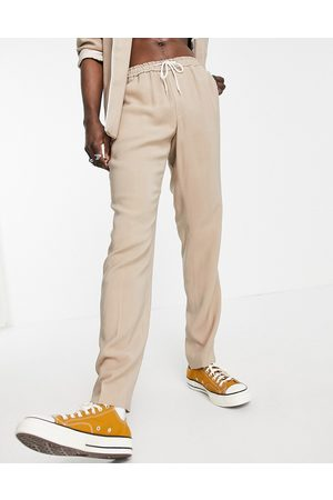 ASOS Slim fit pyjama suit trousers with piping on pocket in camel-Neutral