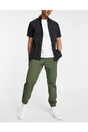 Topman Relaxed nylon jogger trousers in khaki