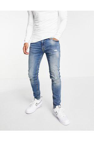 JACK & JONES Intelligence Tom super skinny jeans in midwash