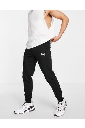 PUMA Men Joggers - Essentials cat logo joggers in
