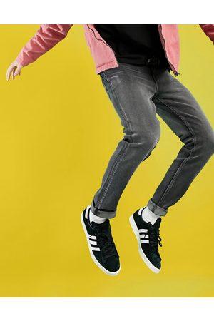 ASOS Men Skinny - Skinny jeans in washed black