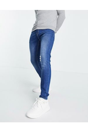 New Look Skinny jeans with rips in mid wash
