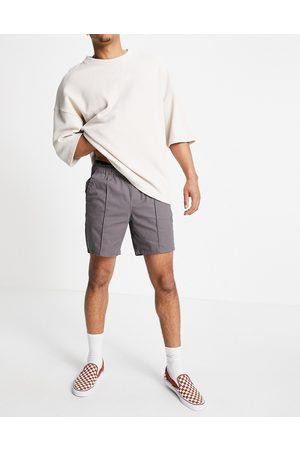 ASOS Men Shorts - Skinny chino shorts with elastic waist and pin tuck in charcoal