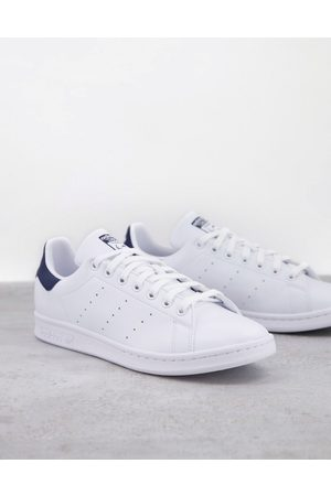 adidas Sustainable Stan Smith trainers in with navy tab