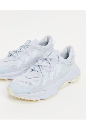 adidas Ozweego trainers in pale blue