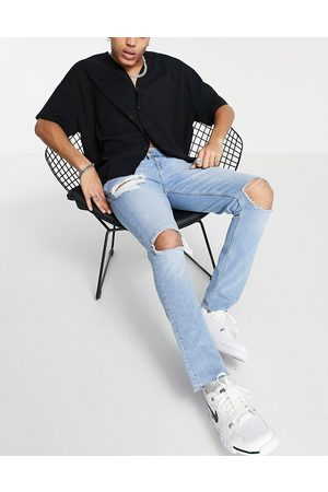 ASOS Skinny jeans with heavy rips and raw hem in light wash