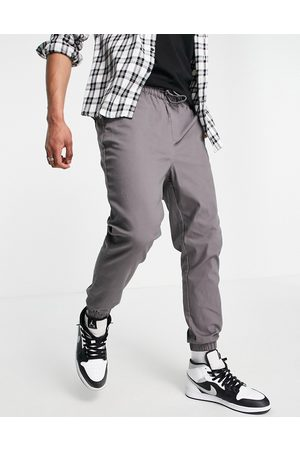 ASOS Tapered chino joggers with elasticated waist in charcoal