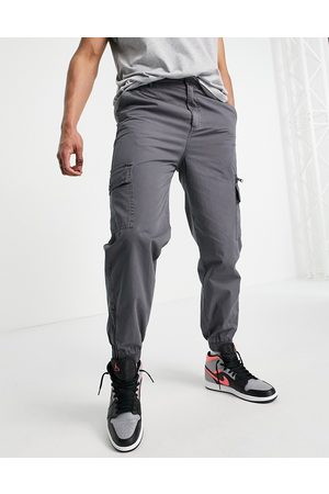 ASOS Tapered washed cargo trousers in dark shadow