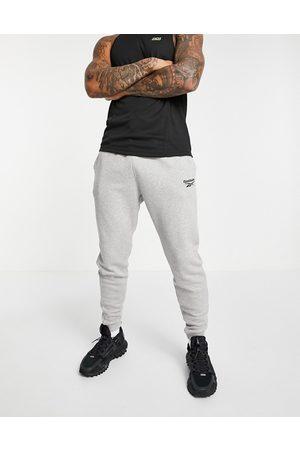Reebok Men Trousers - Training essential fleece joggers in