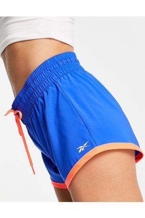 Reebok Training woven shorts in and orange