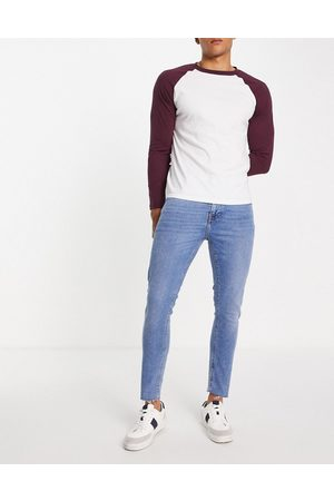 ASOS Skinny jeans in mid wash with raw hem