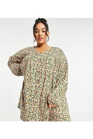 ASOS ASOS DESIGN Curve button through mini smock dress with long sleeves in and pink floral