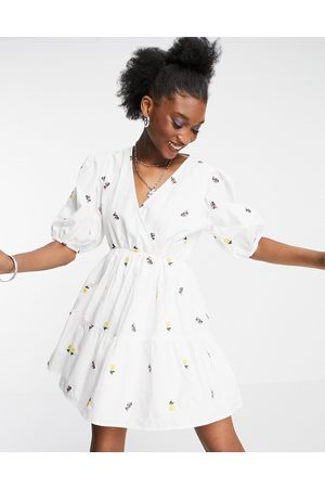 In The Style X Lorna Luxe wrap front tiered mini dress in