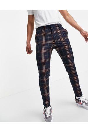 ASOS Skinny ankle grazer smart trouser in navy tartan check