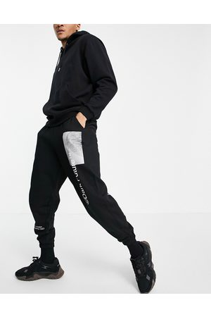 ASOS Men Sets - Co-ord oversized jogger with logo prints in