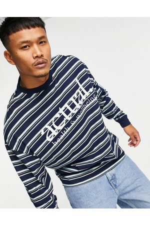 ASOS Actual Oversized long sleeve t-shirt with all over stripe print and chest logo in navy