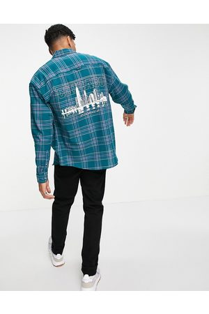 ASOS 90s oversized check shirt with back city print