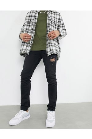 ASOS DESIGN Skinny jeans in washed with thigh abrasions