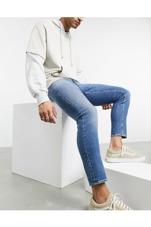 ASOS Men Skinny - Cropped skinny jeans in vintage mid wash with abrasions