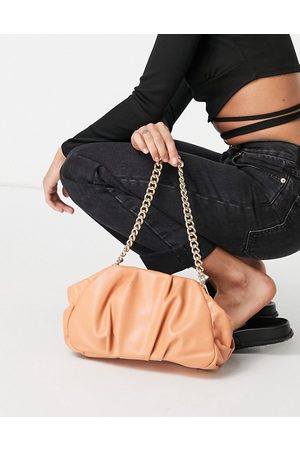 ASOS DESIGN Oversized ruched clutch bag in apricot with detachable shoulder chain