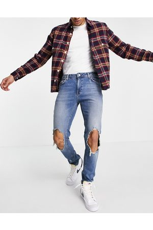ASOS DESIGN Men Skinny - Skinny jeans in mid wash with extreme rips