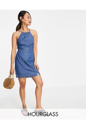 ASOS Hourglass soft denim halterneck slip dress in midwash
