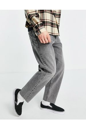 ASOS Relaxed tapered jeans in washed with raw hem