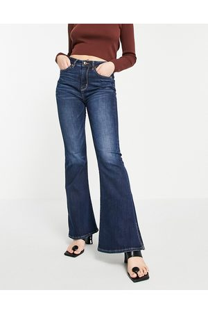 AMERICAN EAGLE Super high rise flared jeans with distressing in dark