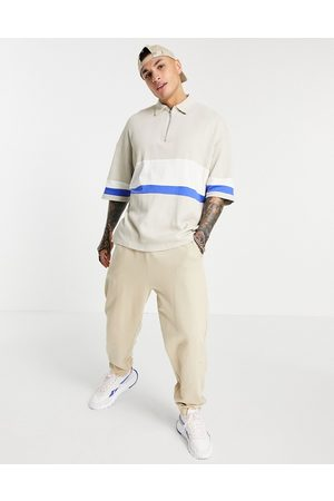 ASOS Oversized polo shirt with half sleeves in rib-Neutral