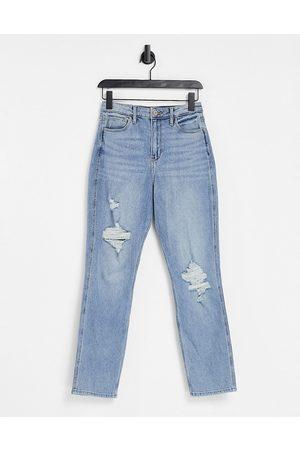 Hollister Knee rip boyfriend jeans in indigo wash