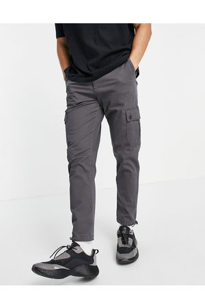 ASOS Tapered cargo trousers in charcoal with toggles