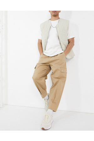 ASOS Oversized tapered cargo joggers in sand-Neutral
