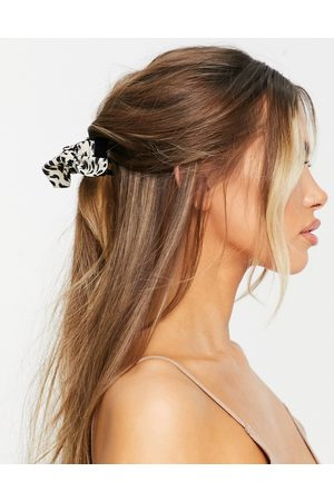 ASOS Hair claw with bow detail in mono leopard