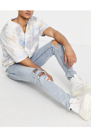 ASOS Skinny jeans in vintage light wash with heavy rips