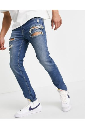 ASOS Skinny jeans in tinted dark wash with heavy rips