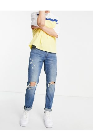 ASOS Slim jeans in mid wash with heavy rips