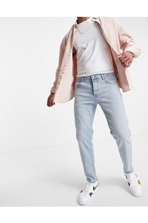 ASOS Stretch tapered jeans in tinted light wash