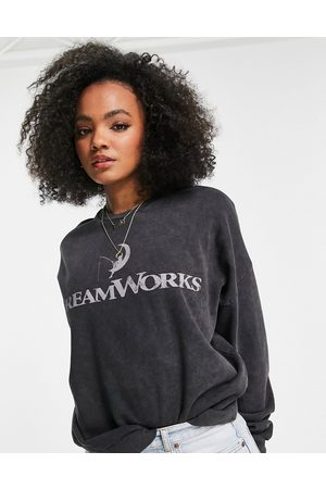 ASOS Oversized Dreamworks graphic sweatshirt in washed charcoal