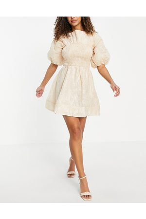 ASOS Jacquard shirred mini skater dress with bow back and puff sleeves in -Neutral