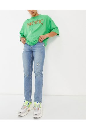 ASOS Stretch slim jeans in mid wash with abrasions