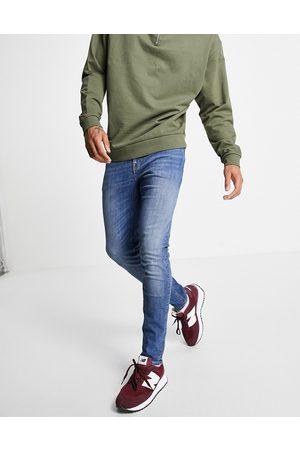 ASOS Skinny jeans in mid wash